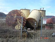 Old tank farm and piping in Hughes